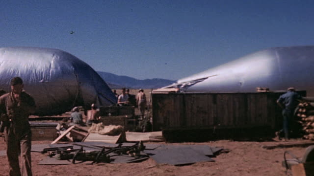 working crew inflating silver colored hot air or hydrogen balloons / new mexico united states - white sands missile range stock videos & royalty-free footage