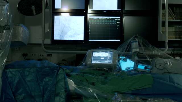 working equipment in operating room - coronary artery stock videos and b-roll footage
