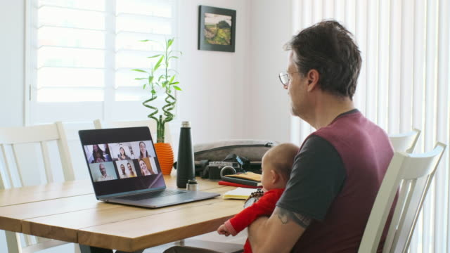 working father at home on a web chat meeting - web conference stock videos & royalty-free footage