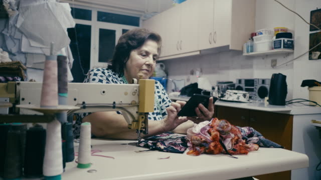 working female senior using digital tablet in the workshop - sewing stock videos & royalty-free footage
