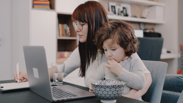 working from home mom - teleworking stock videos & royalty-free footage