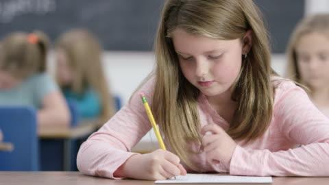 working hard - elementary school stock videos & royalty-free footage