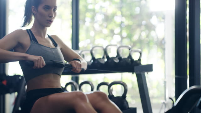 working her legs and arms at the same time - rowing stock videos & royalty-free footage