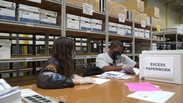 working in bipartisan pairs, canvassers process mail-in ballots in a warehouse at the anne arundel county board of elections headquarters on october... - maryland us state stock videos & royalty-free footage