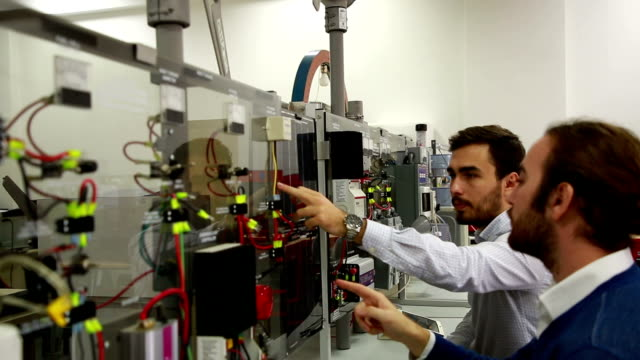 working in laboratory of renewable energy. - tecnico video stock e b–roll