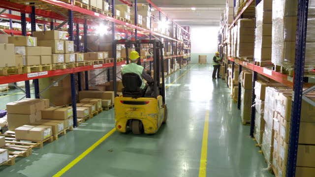 working in the warehouse - forklift truck stock videos and b-roll footage