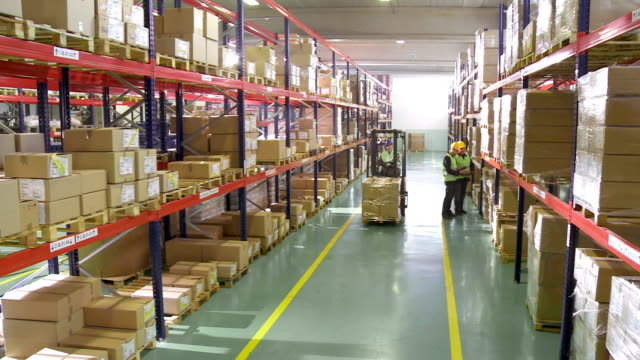 stockvideo's en b-roll-footage met working in the warehouse - heftruck