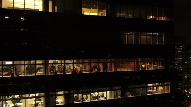working late at night - office block exterior stock videos & royalty-free footage