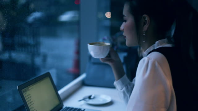 working late, beautiful asian woman working with laptop and drink coffee at night - coffee drink stock videos & royalty-free footage