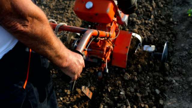 working man with motor cultivator - harrow stock videos & royalty-free footage