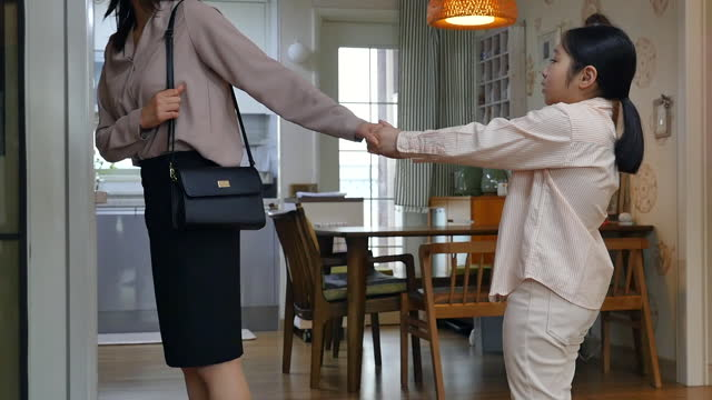 working mom - daughter interrupting mother commuting in living room - working mother stock videos & royalty-free footage