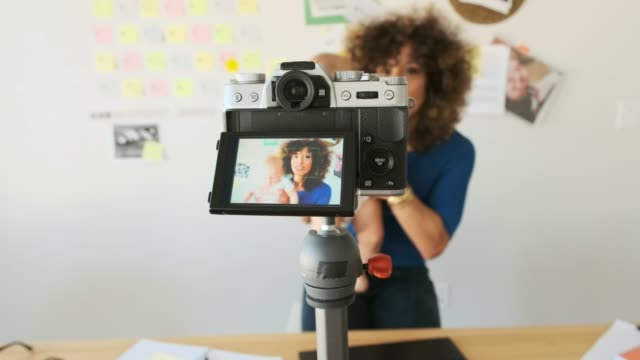 working mother balancing baby and design work - filming stock videos & royalty-free footage