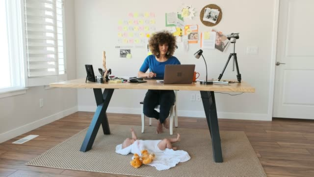 working mother balancing baby and design work - working mother stock videos & royalty-free footage