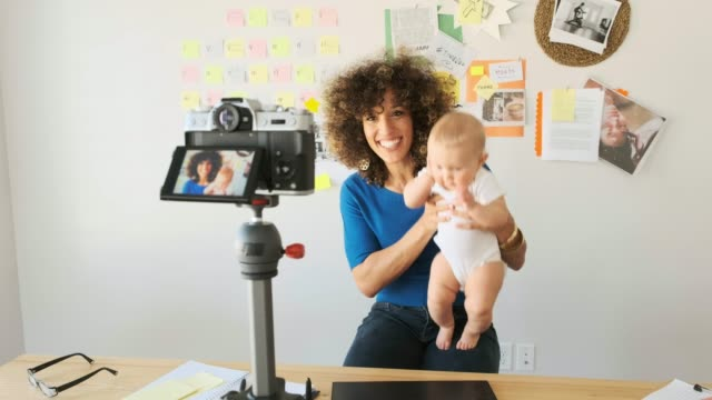 working mother balancing baby and design work - blogging stock videos & royalty-free footage