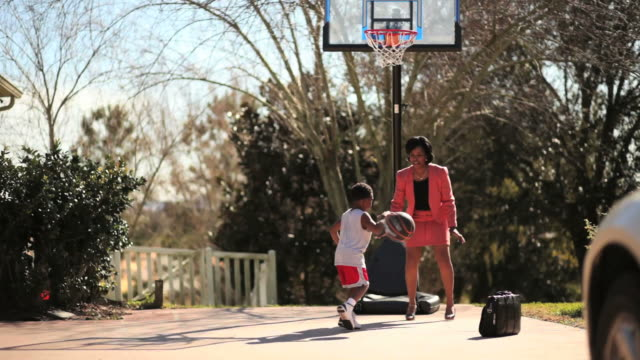 working mother playing basketball with her son - working mother stock videos & royalty-free footage