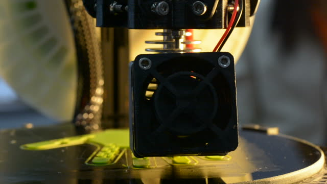 Working of 3D Printer on printing Green Glove
