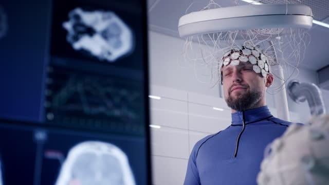 working on brainwave scanning headset. man wearing sensors - headset stock videos & royalty-free footage