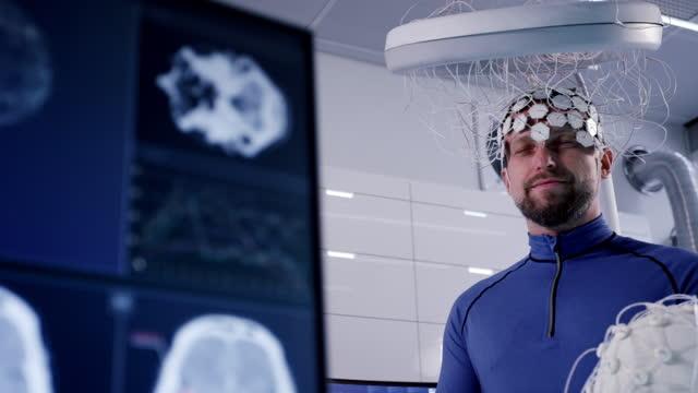 working on brainwave scanning headset. man wearing sensors - neuroscience stock videos & royalty-free footage