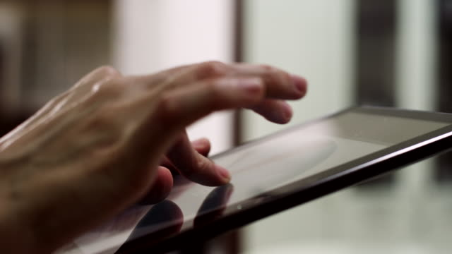 working on digital tablet - digital tablet stock videos & royalty-free footage