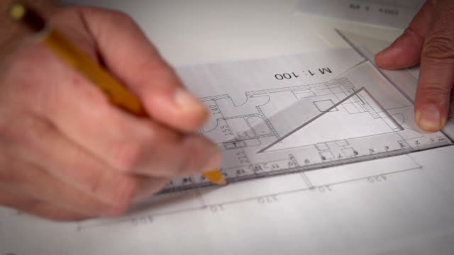 working on house plans - blueprint stock videos & royalty-free footage