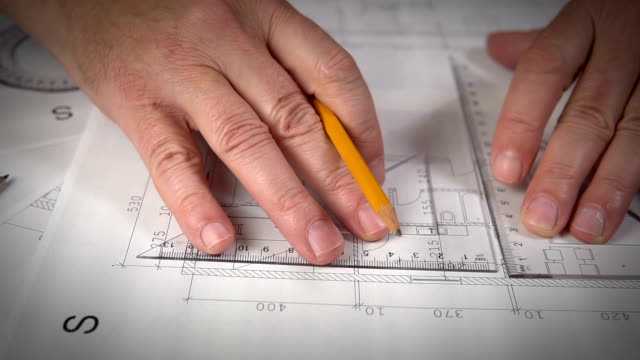 working on house plans - instrument of measurement stock videos & royalty-free footage