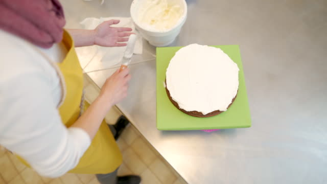 working on icing - decorating a cake stock videos and b-roll footage