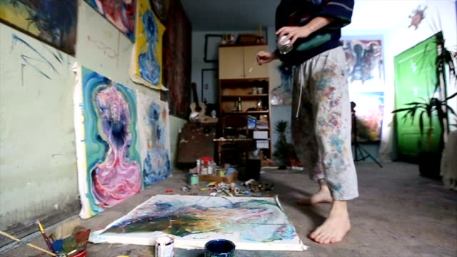 working on painting in studio - atelier tent stock videos and b-roll footage