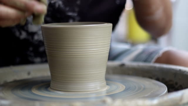 working on pottery wheel - pottery stock videos & royalty-free footage