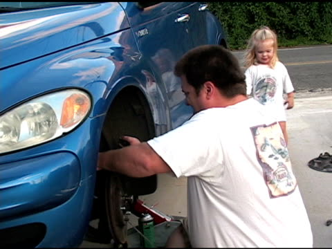 working on the car with daddy - wrench stock videos and b-roll footage