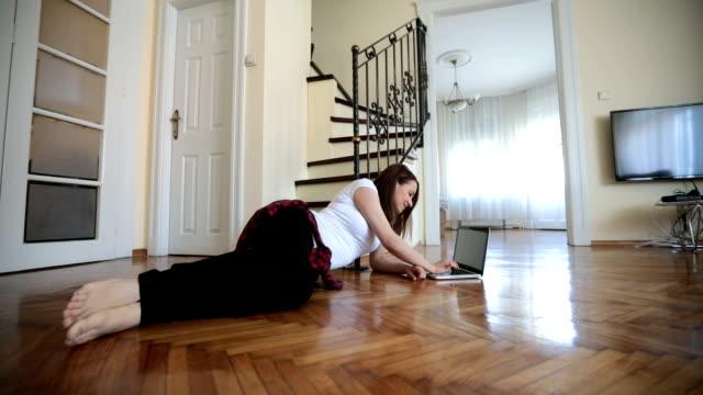 working on the living room floor - wooden floor stock videos & royalty-free footage