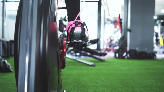 working out at gym. - exercise bike stock videos & royalty-free footage