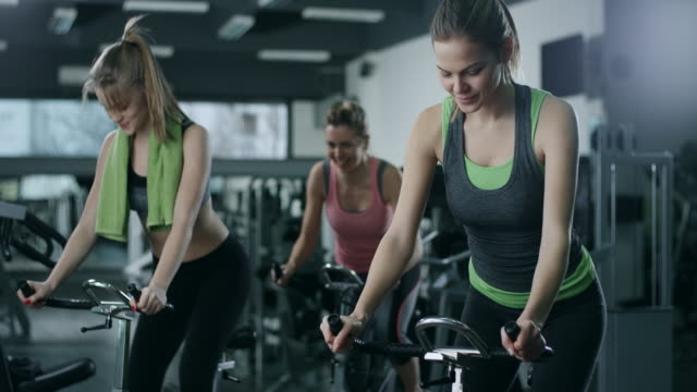 working out on stationary bikes - instructor stock videos & royalty-free footage