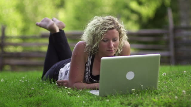 working outdoors - lying on front stock videos & royalty-free footage