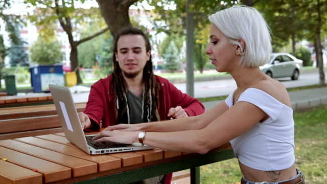 working outdoors with technologies at university campus - body adornment stock videos and b-roll footage