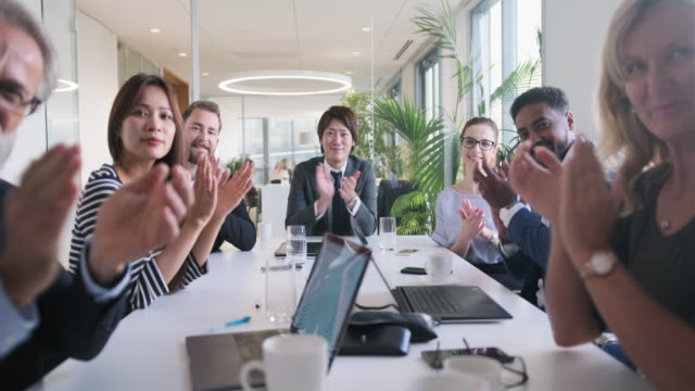 working portrait of businesspeople applauding in meeting - clapping hands stock videos & royalty-free footage