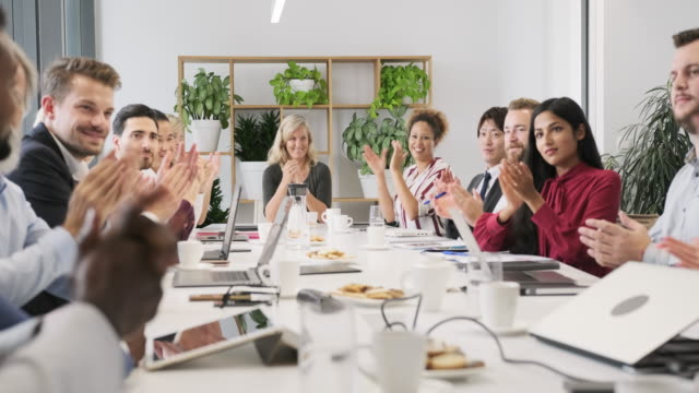 working portrait of businesspeople applauding in meeting - conference table stock videos & royalty-free footage