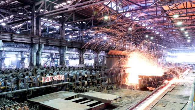 working steel rolling factory interior, time lapse.