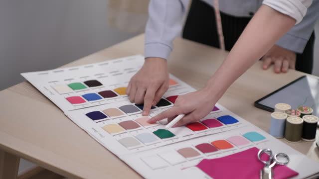 working table fashion designer ,designer clothing - designer clothing stock videos & royalty-free footage