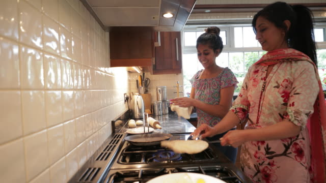 working together in the kitchen - two generation family stock videos & royalty-free footage