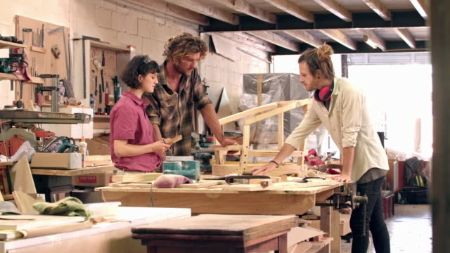 working together on their latest furniture design - craftsperson stock videos and b-roll footage
