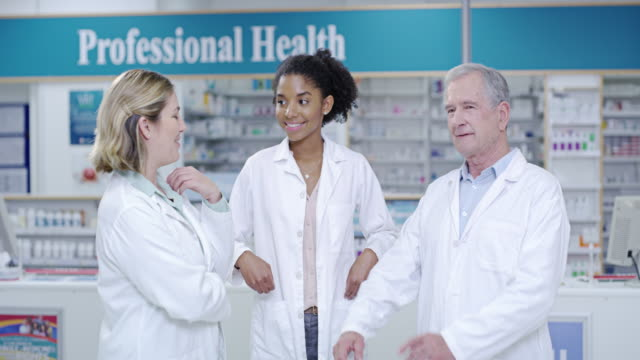 working together to keep you well - laboratory coat stock videos & royalty-free footage