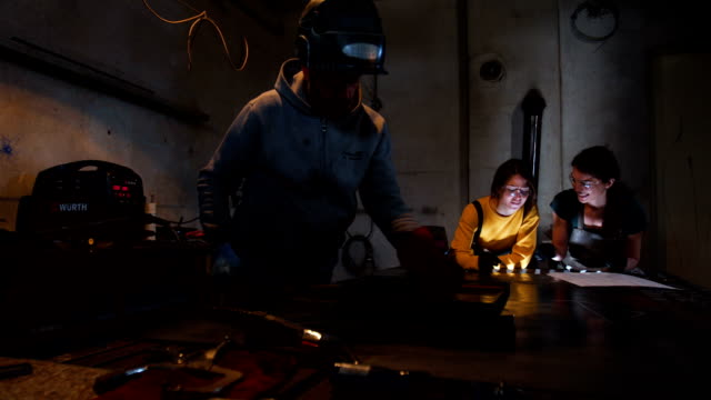 working together - welding torch stock videos & royalty-free footage
