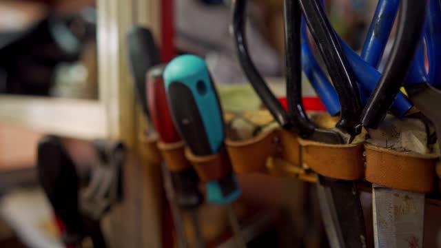 working tools in cobbler workshop - animal skin stock videos & royalty-free footage