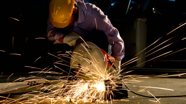 working with angle grinder, cutting pipe