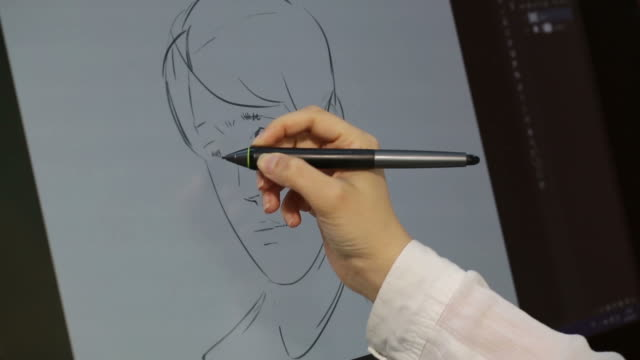 working with drawing tablet for a computer - 製図板点の映像素材/bロール