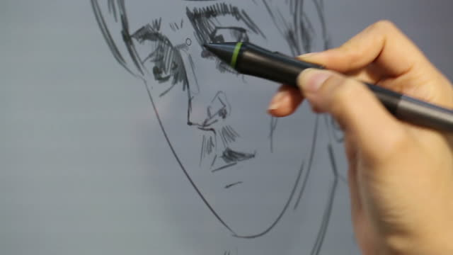 vídeos de stock, filmes e b-roll de working with drawing tablet for a computer - prancheta