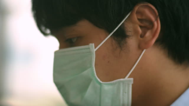 working with hygienic mask - asian man coughing stock videos & royalty-free footage
