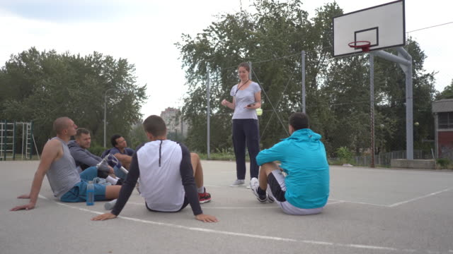 working with male athletes - role reversal stock videos & royalty-free footage