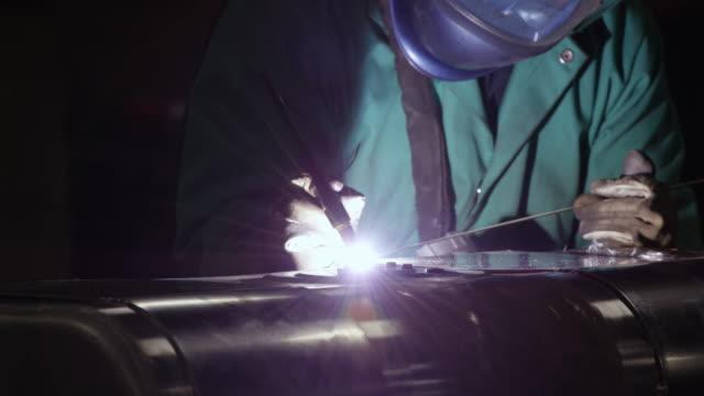 working with metal - welding helmet stock videos & royalty-free footage
