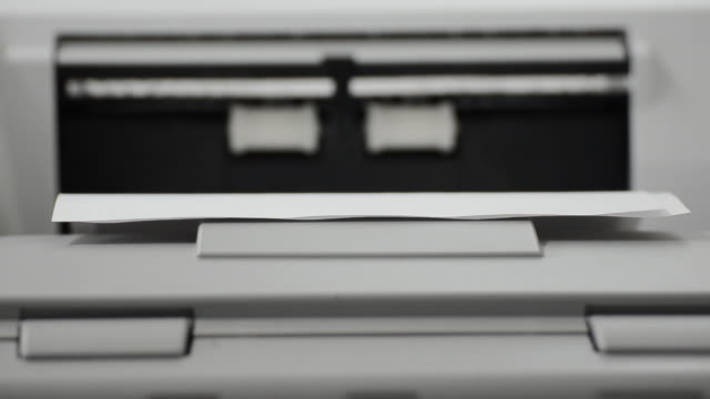 working with photocopier machine - printing out stock videos and b-roll footage